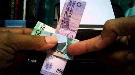Sulap Kartu Melayang trik sulap uang kertas tembus