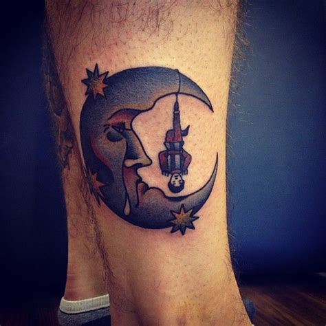tattoo city instagram miserable moon with hanging man and stars on the leg