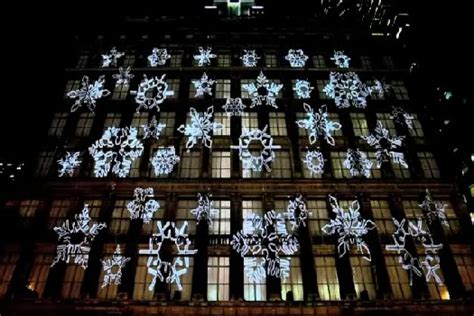3d santa christmas light projection show saks fifth avenue holiday light show features 3d