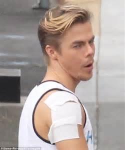 derek hough reveals bandaged shoulder backstage at dancing