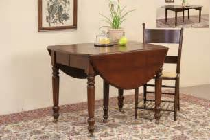 sold oval 1890 antique drop leaf dining table