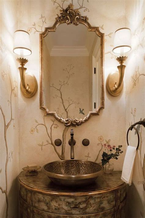 beautiful powder room design featuring brass sconces