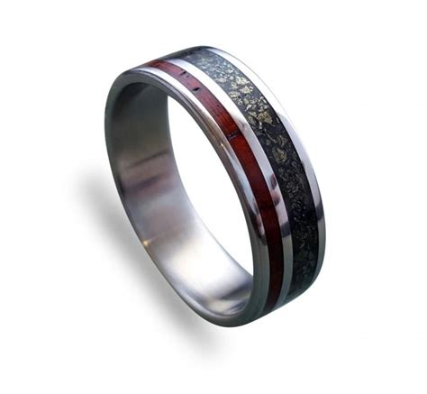 titanium ring with cocobolo wood and crushed pyrite inlay