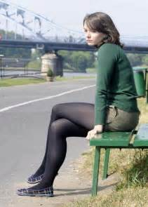 green sweater army green shorts and black pantyhose