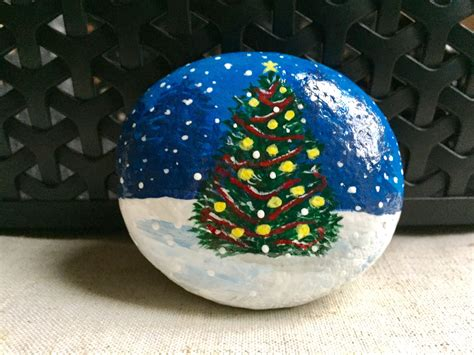 christmas tree on a rock tree painted rock tree in snow painted