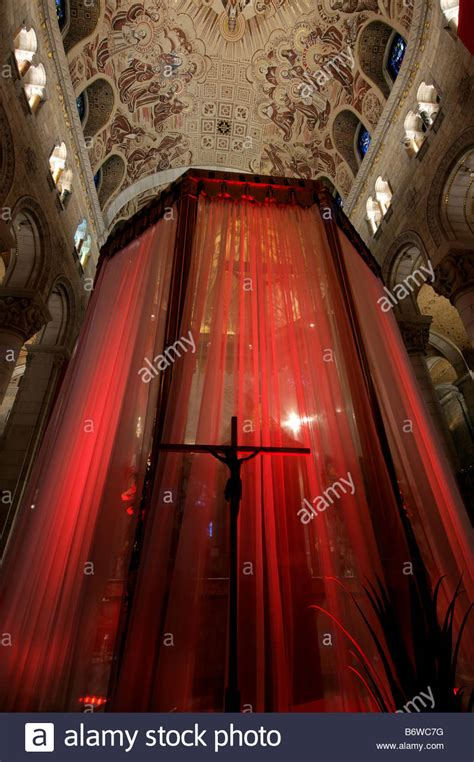 spinning crucifix crimson drapes stock a statue of jesus on the cross silhouetted against a