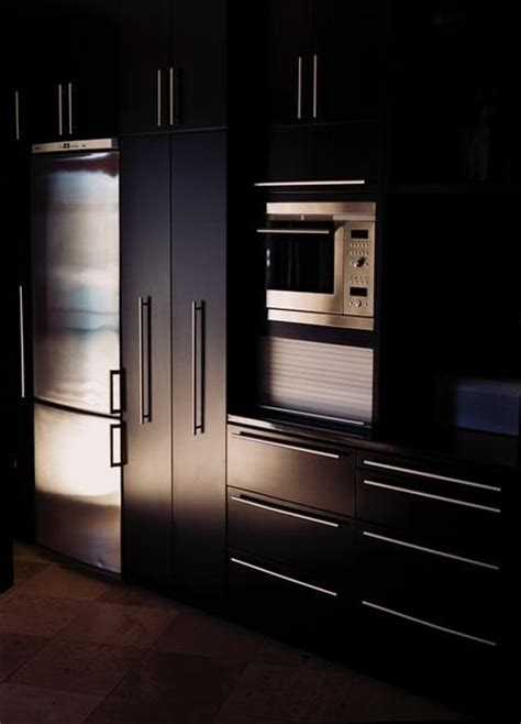 Staining Kitchen Cabinets Black by Painting Or Staining Kitchen Cabinets In Black Onyx