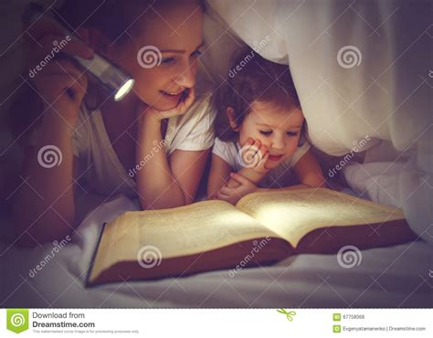 reading l bed cl child with book royalty free stock photography