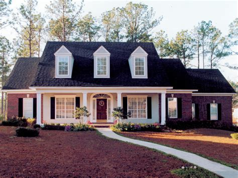 house plans with front porch and dormers 1950 cape cod brick front brick home with sweeping front