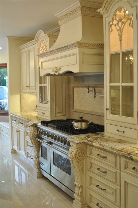 ornate kitchen cabinets french creamy white kitchen is traditional ornate with