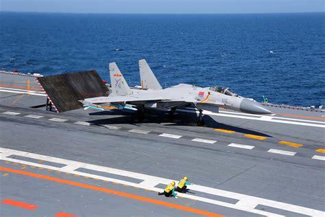 J-15 carrier-borne fighter jets aboard aircraft carrier ... J 15