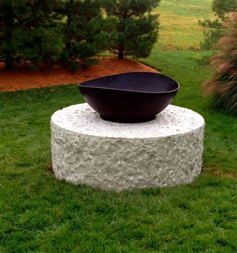 floating pit pit floating in a pool of turf contemporary