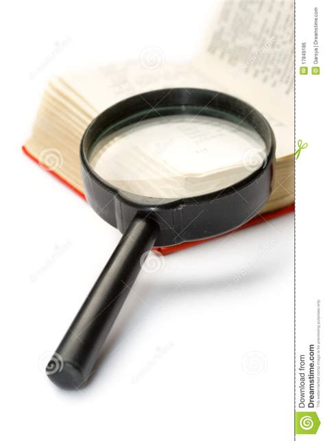 Novel Glass magnifying glass and book royalty free stock image image 17849186