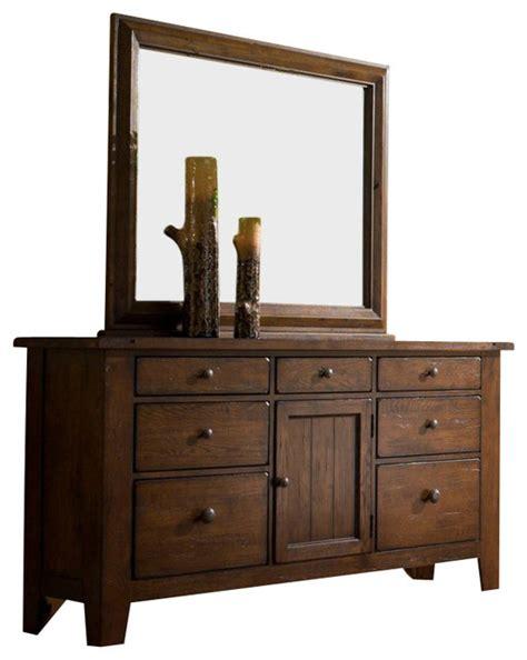 Attic Heirlooms Dresser by Broyhill Attic Heirlooms Oak Stain 7 Drawer Door Dresser