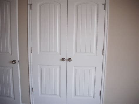 Wood Closet Doors For Bedrooms Simple Bedroom With Closet Doors And White Wooden Closet Door Design Closet Organizers