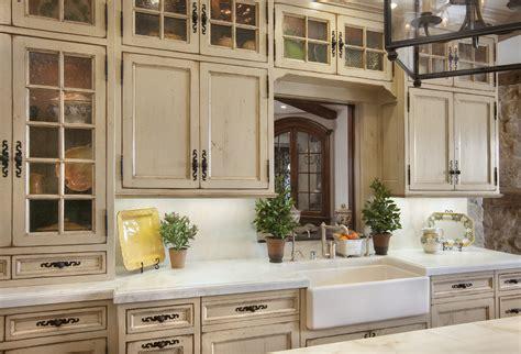 distressed white kitchen cabinets Kitchen Mediterranean with apron sink distressed finish