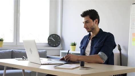 freelance graphic designer sketching on tablet working