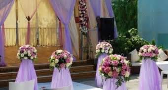 Purple tulle and purple flowers for wedding decoration