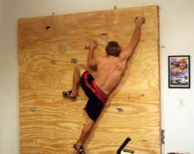 Dan climbing on a freshly installed rock climbing wall