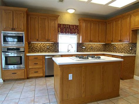 bronze cabinet hardware with stainless appliances rich oak wood cabinets with raised panels and rub
