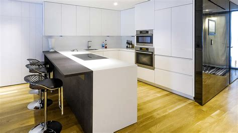 Corian And Wood Corner Kitchen In Corian And Wood In The Center Of