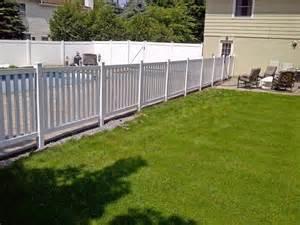 Vinyl columbia yard fence installed around an inground pool in