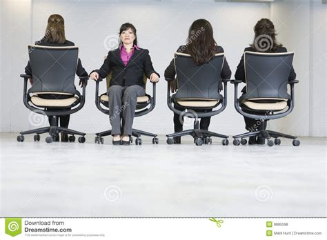 business women sitting  office chairs stock photo image  photography