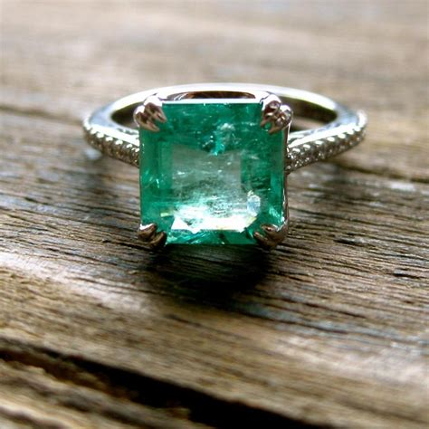 emerald engagement ring in 18k white