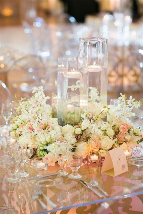 white flower floating candle wedding reception centerpiece