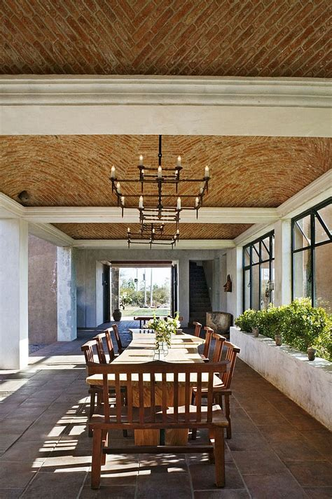 expansive mediterranean dining room  natural edge
