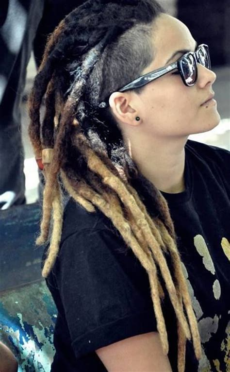 shaved sides with dreads dark brown dreads with blonde tips shaved side and some