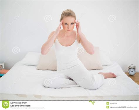 sitting in bed natural annoyed blonde sitting in bed stock photo image