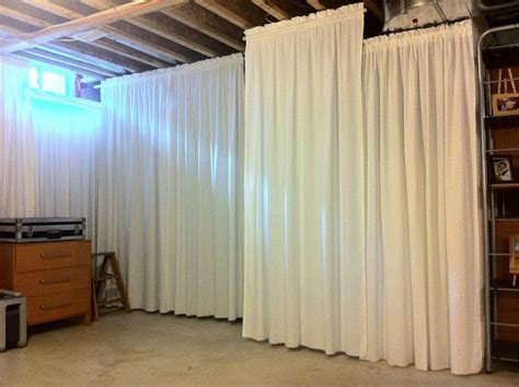 HouseOnaShoestring: Hang curtains in unfinished basement