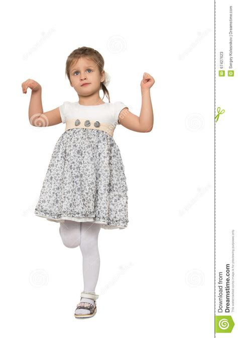 tiny petite girl stands on one leg stock image image of people face