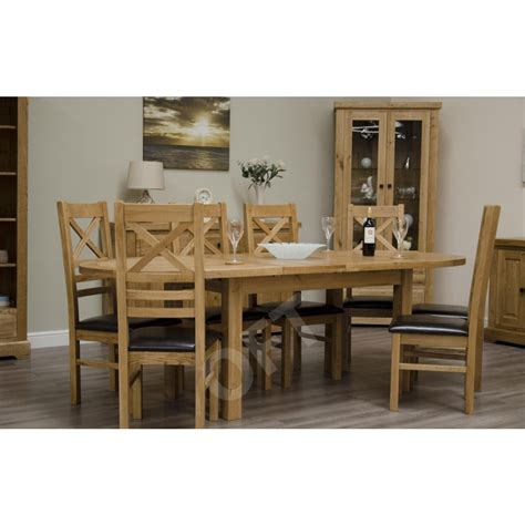 oval oak dining table and chairs montero oval extending dining table and six chairs set