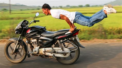 motor bike motorbike pulls poses on speeding bike