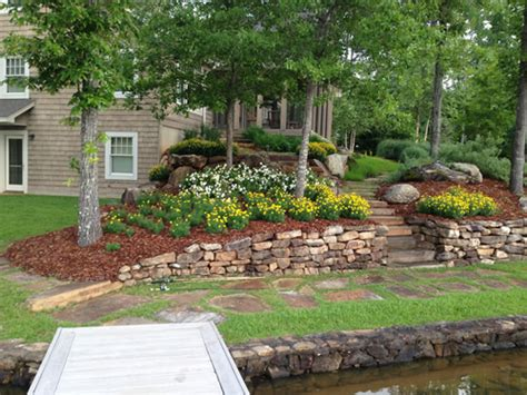 rock wall and landscaping hilltop landscaping lake