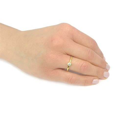 gold ring on finger yellow gold engagement rings