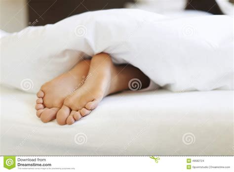 bed feet close up of woman s feet stock photo image 49582724
