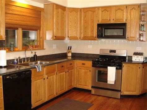 white granite countertop brown wood paint cabinets design gray paint color kitcen cabinetry oak