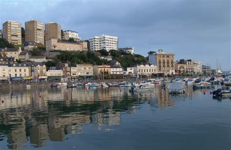 houses to buy torquay england devon torquay seafront promenade waves surf sand beach high tide houses hotels