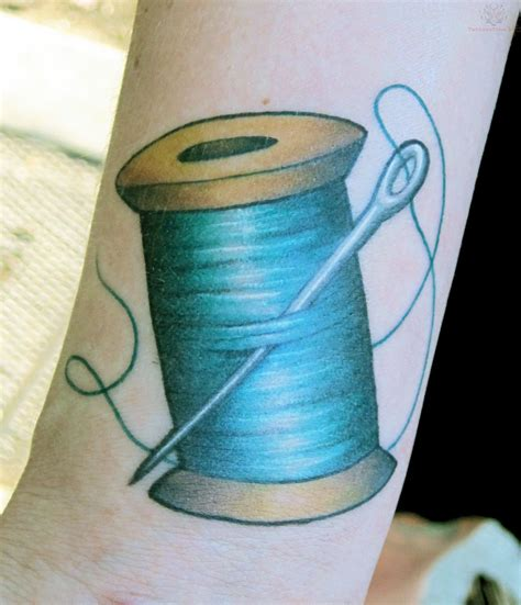 needle and thread tattoo blue thread spool and needle