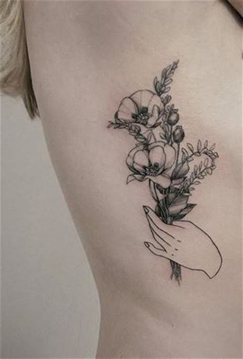tattoo of a hand holding flowers awesome hand images part 2 tattooimages biz