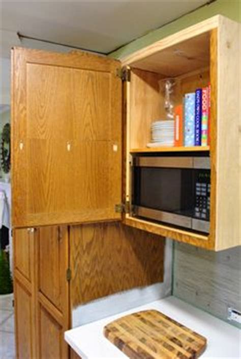 microwave hideaway cabinet for the home pinterest 1000 images about tired of looking at my microwave on
