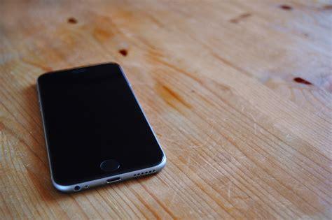 hands free desk phone free images desk smartphone hand apple wood