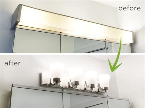 how to take down bathroom light fixture bathroom vanity light fixtures up or down renocompare