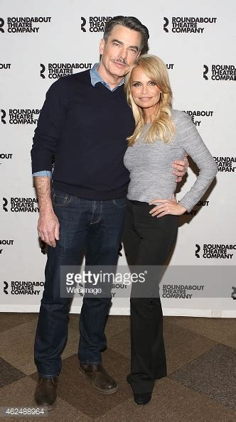 kristin chenoweth cuddles peter gallagher for on the quot on the twentieth century quot broadway cast photocall getty