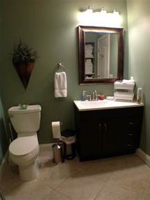 bathrooms tiled white vanity green walls basement