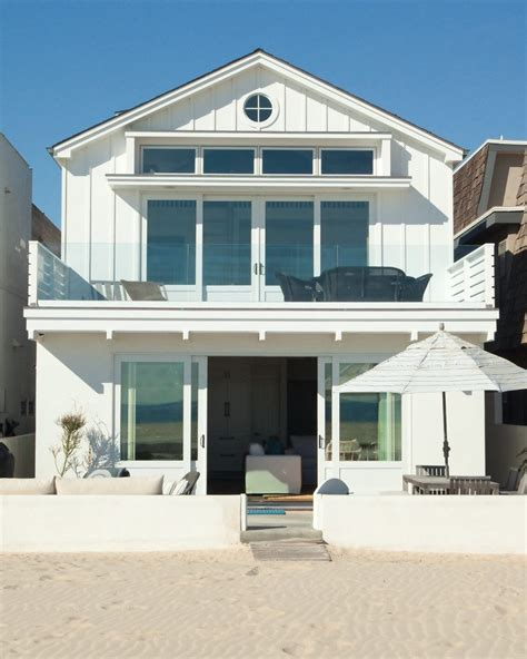 Tropical beach cottage exterior beach style with sliding glass door beach patio white house