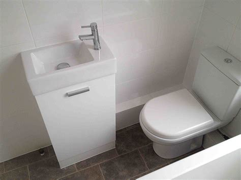 small basin close coupled toilet and small basin with bathroom